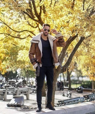 How to Wear a Brown Shearling Jacket For Men: You'll be amazed at how easy it is for any gentleman to throw together this laid-back ensemble. Just a brown shearling jacket and black chinos. Our favorite of a countless number of ways to complement this look is with a pair of black suede chelsea boots.