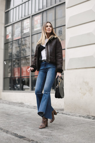 How to wear: dark brown shearling jacket, white crew-neck t-shirt, blue flare jeans, brown snake leather ankle boots