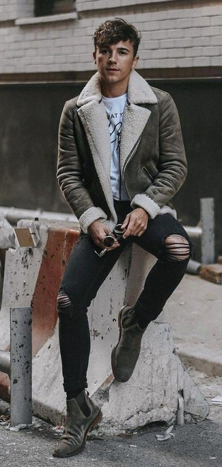How to wear: grey shearling jacket, white and black print crew-neck t-shirt, black ripped skinny jeans, grey suede chelsea boots