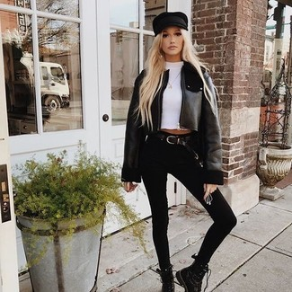 How to wear: black shearling jacket, white crew-neck t-shirt, black skinny jeans, black leather lace-up flat boots