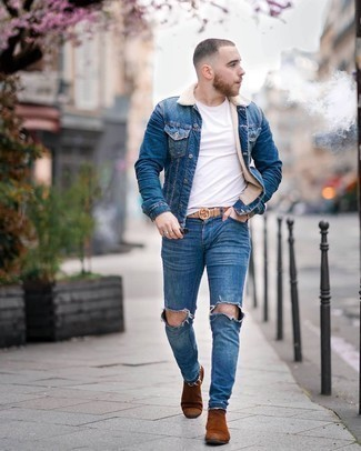 Blue Denim Shearling Jacket Outfits For Men: A blue denim shearling jacket and blue ripped skinny jeans will add extra cool to your off-duty lineup. Dial down the casualness of your look by finishing off with tobacco suede chelsea boots.