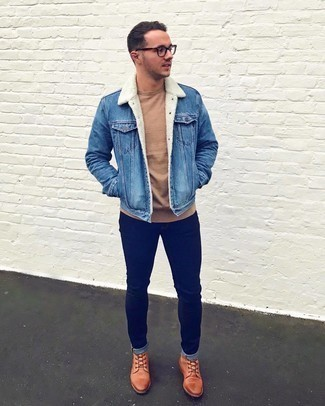 Blue Denim Shearling Jacket Outfits For Men: A blue denim shearling jacket and navy skinny jeans are a cool outfit formula to keep in your menswear arsenal. Parade your classy side by rounding off with a pair of tobacco leather casual boots.