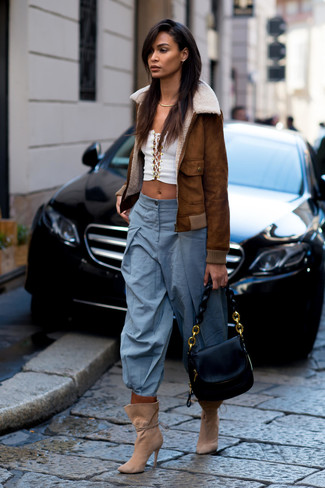 How to wear: brown shearling jacket, white cropped top, light blue wide leg pants, tan suede ankle boots