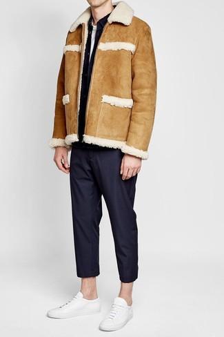 How to wear: tan shearling jacket, black denim jacket, white crew-neck t-shirt, black dress pants