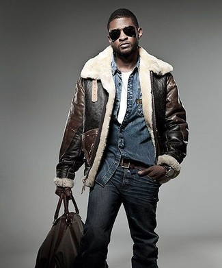 How to wear: dark brown shearling jacket, navy denim shirt, white crew-neck t-shirt, navy jeans