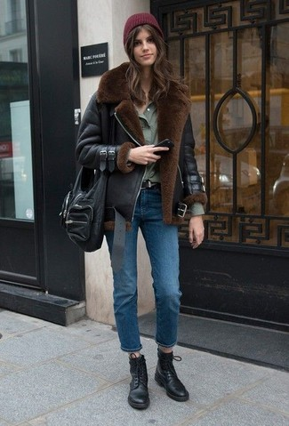 How to wear: black shearling jacket, olive dress shirt, blue jeans, black leather lace-up flat boots