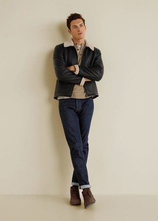 Henley Sweater Outfits: A well-executed combination of a henley sweater and navy jeans will set you apart instantly. Add brown suede desert boots to the mix and off you go looking spectacular.
