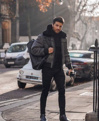 How to Wear a Black Leather Duffle Bag For Men: For a casual and cool look, try teaming a grey shearling jacket with a black leather duffle bag — these items fit really great together. Don't know how to round off this getup? Round off with a pair of black leather chelsea boots to kick it up a notch.