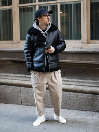 Navy Baseball Cap Outfits For Men: For the style that looks as chill as it can get, wear a black shearling jacket and a navy baseball cap. When it comes to shoes, this getup is finished off brilliantly with white canvas high top sneakers.