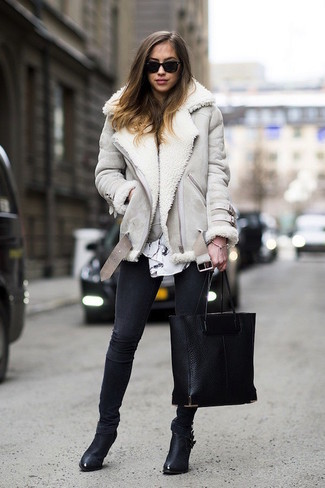 How to wear: grey shearling jacket, white and black print long sleeve blouse, black skinny jeans, black leather ankle boots