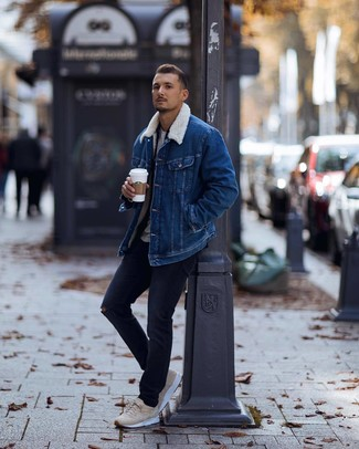 How to wear: blue denim shearling jacket, navy flannel long sleeve shirt, grey crew-neck t-shirt, navy ripped jeans