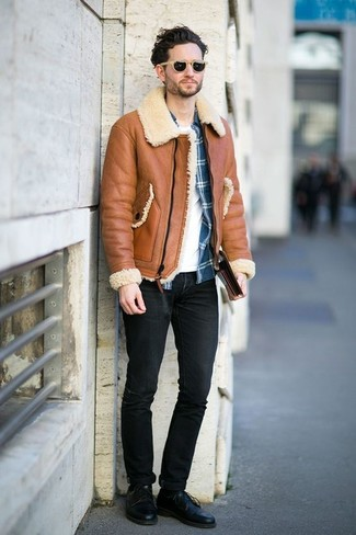 How to Wear Black Jeans In Winter For Men: Try pairing a tobacco shearling jacket with black jeans to pull together a day-to-day look that's full of style and character. If you want to instantly smarten up this outfit with one item, why not complement your look with black leather derby shoes? When the cold season leaves you uninspired in the outfit department, this outfit just might solve the problem.