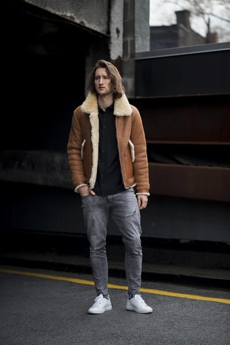 How to wear: brown shearling jacket, black long sleeve shirt, grey ripped jeans, white leather low top sneakers