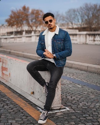 Blue Denim Shearling Jacket Outfits For Men: Why not rock a blue denim shearling jacket with charcoal skinny jeans? As well as very comfortable, these two pieces look nice when teamed together. Unimpressed with this outfit? Enter black and white canvas high top sneakers to switch things up.