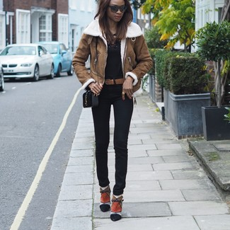 How to wear: brown shearling jacket, black long sleeve t-shirt, black skinny pants, multi colored suede ankle boots