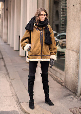 How to wear: tobacco shearling jacket, black skinny jeans, black suede knee high boots, grey wool gloves