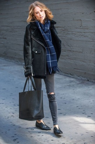 How to wear: black shearling jacket, charcoal ripped skinny jeans, black leather loafers, black snake leather tote bag