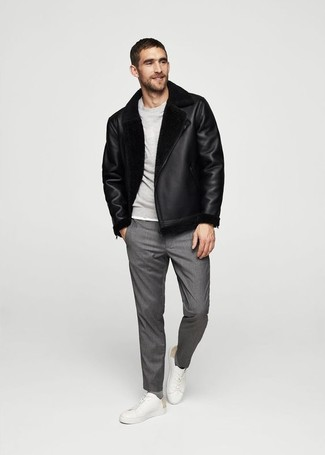 How to wear: black shearling jacket, grey sweatshirt, grey dress pants, white leather low top sneakers