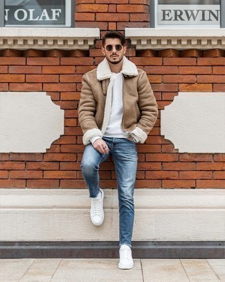 Blue Skinny Jeans Spring Outfits For Men: For a casual ensemble, make a tan shearling jacket and blue skinny jeans your outfit choice — these pieces work beautifully together. If you're on the fence about how to round off, complement this look with white leather low top sneakers. This look is our idea of perfection for those comfortable days of spring.
