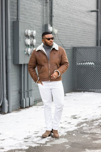 How to wear: brown shearling jacket, grey turtleneck, white chinos, brown suede chelsea boots