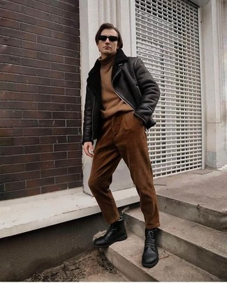 Black Leather Casual Boots Outfits For Men: Pairing a black shearling jacket with brown corduroy chinos is an on-point idea for a cool and casual getup. A pair of black leather casual boots will be a welcome complement for your ensemble.