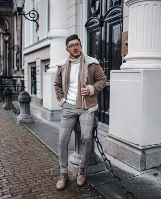 Brown Shearling Jacket Outfits For Men: Nail the casually dapper ensemble by wearing a brown shearling jacket and grey plaid chinos. Tan leather casual boots are an easy way to inject a hint of class into your ensemble.