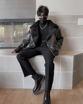 Men's Outfits 2021: A black shearling jacket and black chinos are essential in any modern gentleman's functional casual closet. Black leather chelsea boots are an effective way to breathe a touch of polish into this outfit.
