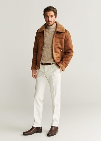 1152+ Winter Outfits For Men: When the situation allows a relaxed look, you can easily rock a brown shearling jacket and white chinos. Here's how to dress it up: dark brown leather chelsea boots. With a look like this in your winter sartorial collection, you'll manage to stay comfortable and look stylish despite the extreme weather.