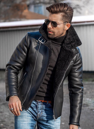 How to wear: black shearling jacket, black turtleneck, blue jeans, tobacco woven leather belt