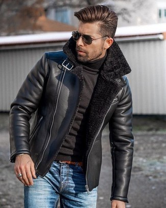 How to wear: black shearling jacket, black turtleneck, blue jeans, tobacco leather belt
