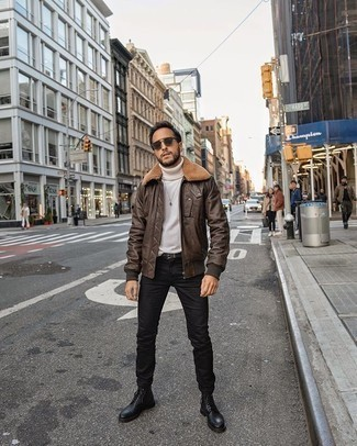 Black Jeans Winter Outfits For Men: This pairing of a dark brown shearling jacket and black jeans will allow you to parade your skills in men's fashion even on weekend days. To give this ensemble a smarter touch, rock a pair of black leather casual boots. We suggest this one if you're scouting for a comfy outfit that's as stylish as it is comfortable.