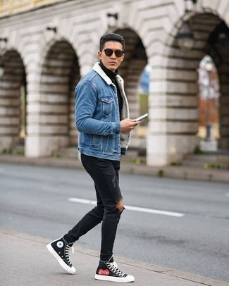 Black Ripped Jeans Outfits For Men: If you're a jeans-and-a-tee kind of guy, you'll like the straightforward pairing of a blue denim shearling jacket and black ripped jeans. The whole ensemble comes together when you add black print canvas high top sneakers to the mix.