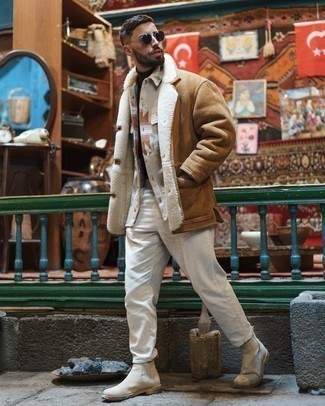 Dark Brown Turtleneck Outfits For Men: This pairing of a dark brown turtleneck and white jeans combines comfort and confidence and helps you keep it low profile yet current. Add a pair of beige suede chelsea boots to this ensemble for a masculine aesthetic.