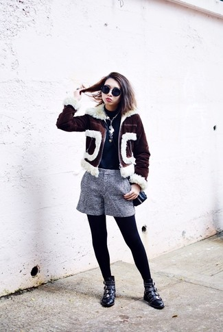 How to wear: dark brown shearling jacket, navy turtleneck, navy and white check shorts, black studded leather ankle boots