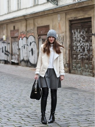 How to Wear a Beige Shearling Jacket For Women: This combination of a beige shearling jacket and a grey skater skirt is super easy to copy and so comfortable to wear all day long as well! Get a bit experimental when it comes to shoes and rock a pair of black leather over the knee boots.