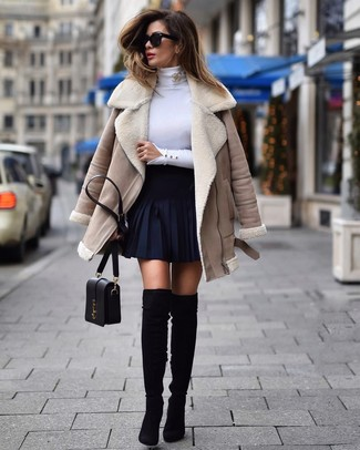 How to wear: beige shearling jacket, white turtleneck, navy skater skirt, black suede over the knee boots