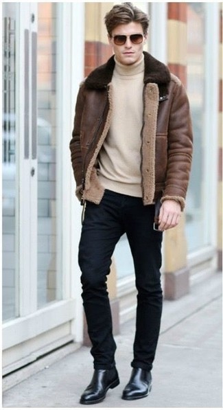 How to wear: brown shearling jacket, beige turtleneck, black skinny jeans, black leather chelsea boots