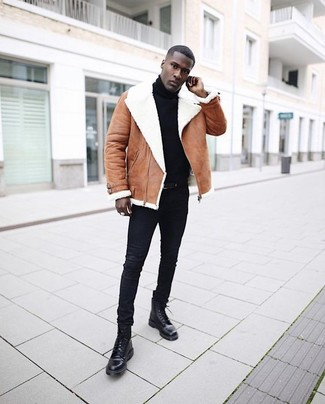 How to wear: brown shearling jacket, black turtleneck, black skinny jeans, black leather casual boots