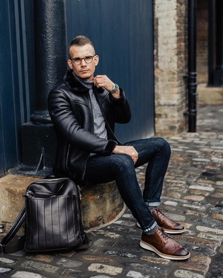 How to wear: black shearling jacket, grey turtleneck, navy skinny jeans, brown leather brogues