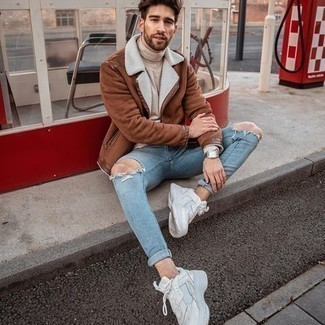 Light Blue Ripped Skinny Jeans Outfits For Men: Marrying a brown shearling jacket and light blue ripped skinny jeans will prove your expertise in menswear styling even on off-duty days. Let your outfit coordination expertise truly shine by completing your outfit with a pair of white athletic shoes.
