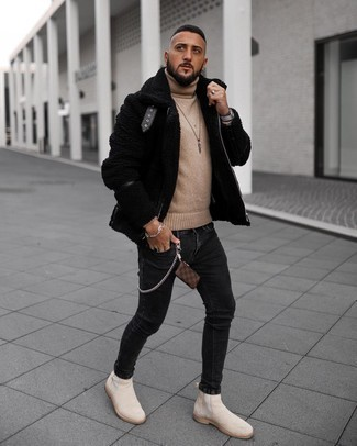 Tan Suede Chelsea Boots with Black Jeans Outfits For Men: Pairing a black shearling jacket with black jeans is an amazing option for an off-duty but stylish look. Tap into some Idris Elba dapperness and class up your look with a pair of tan suede chelsea boots.