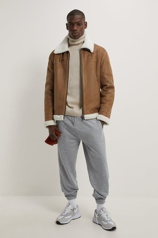 Red Beanie Outfits For Men: Team a tan shearling jacket with a red beanie for comfort dressing with an edgy finish. Complete this look with grey athletic shoes for extra style points.