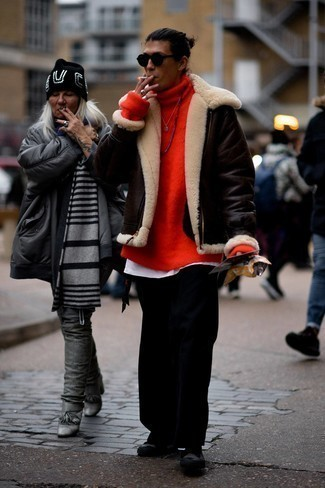 Shearling Jacket Outfits For Men: This combo of a shearling jacket and black chinos is ideal for off-duty days. Go the extra mile and shake up your getup by wearing a pair of black canvas low top sneakers.