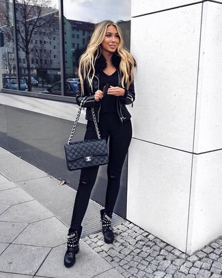 How to wear: black leather shearling jacket, black v-neck sweater, black ripped skinny jeans, black studded leather ankle boots
