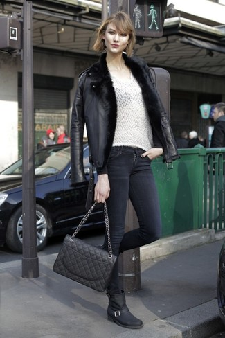 How to wear: black shearling jacket, white v-neck sweater, black skinny jeans, black leather mid-calf boots