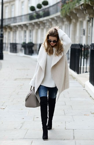 How to wear: beige shearling vest, white knit oversized sweater, blue jeans, black suede over the knee boots