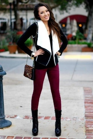 Stand out among other stylish civilians in a monochrome shearling vest and dark red fitted pants. Black chunky leather lace-up ankle boots are a smart choice to complete the look.