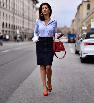 How to Wear a Light Blue Dress Shirt For Women: Marry a light blue dress shirt with a navy suede sheath dress and you'll look incredibly stunning anywhere anytime. Complete your look with a pair of red suede pumps and the whole ensemble will come together perfectly.