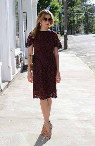 This combination of a burgundy lace sheath dress and clear earrings is the perfect balance between feminine and casual. A pair of beige leather gladiator sandals brings the dressed-down touch to the outfit. This combination has all the elements of your summer favorite.