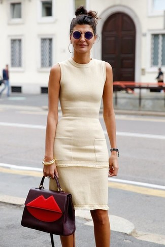 How to wear: beige sheath dress, burgundy leather satchel bag, black sunglasses, gold bracelet